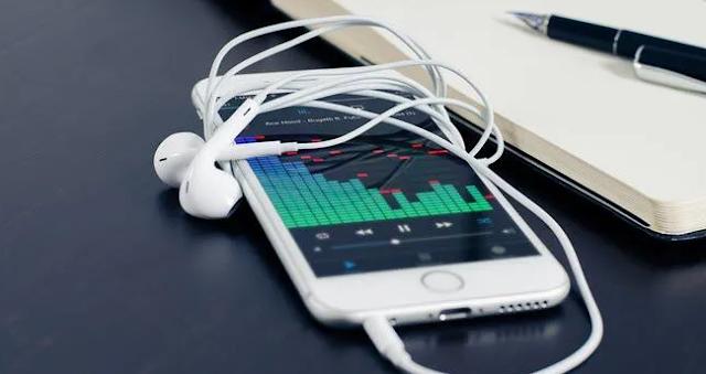 Perbandingan Spotify dengan Apple Music Terbaru