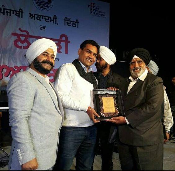 Receiving Award from Mr. Kapil Mishra – Cabinet Minister, Delhi Government