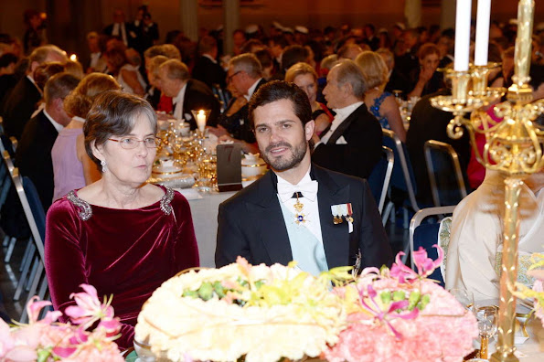 Queen Silvia, Crown Princess Victoria of Sweden and Prince Daniel, Prince Carl Philip and Princess Sofia, Princess Madeleine and Christopher O'Neill, Princess Christina attend the Nobel Prize Banquet 2015