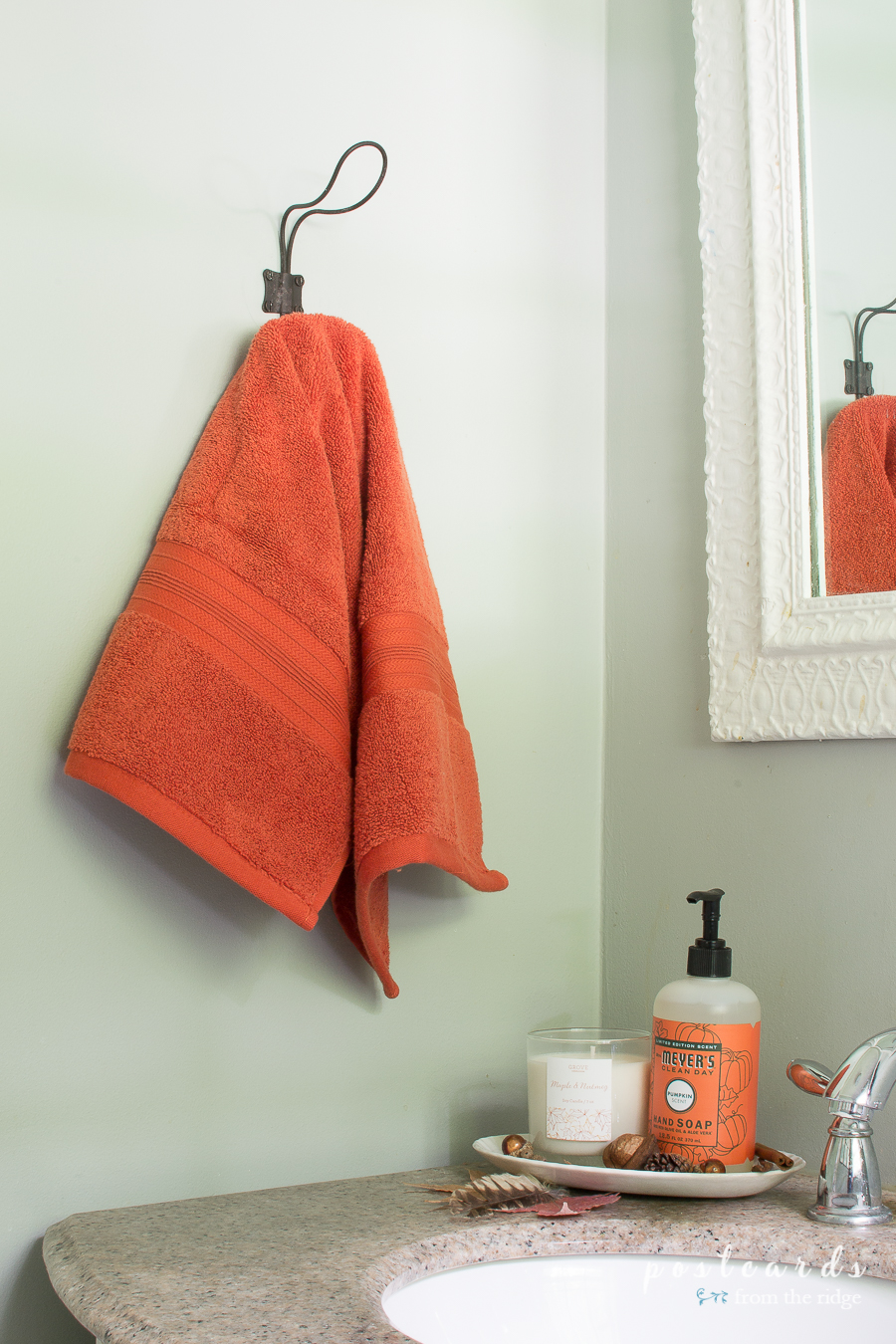 orange towel and pumpkin mrs meyers hand soap
