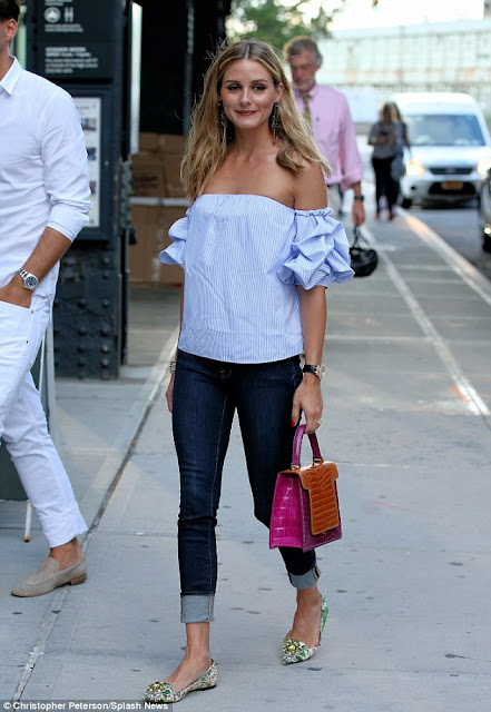 #OliviaPalermo in a ruffle blouse in light blue with a pink top handle handbag and green floral flats, celebrity outfit ideas for spring