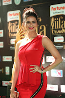 Meenakshi Dixit in Red One Shoulder Red Zipped up gown at IIFA Utsavam Awards022.JPG