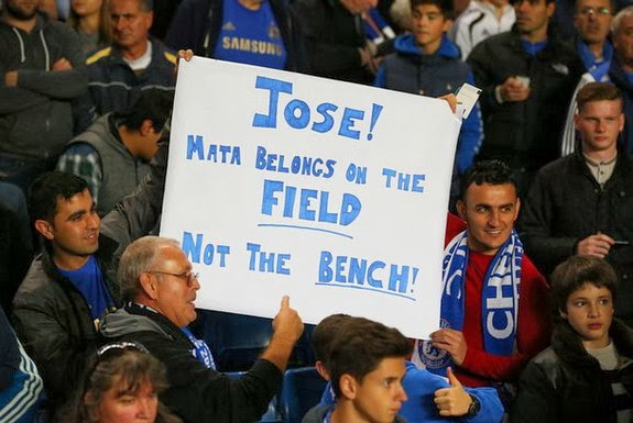 Chelsea fans holds a banner suggesting José Mourinho on how to use fan favourite Juan Mata