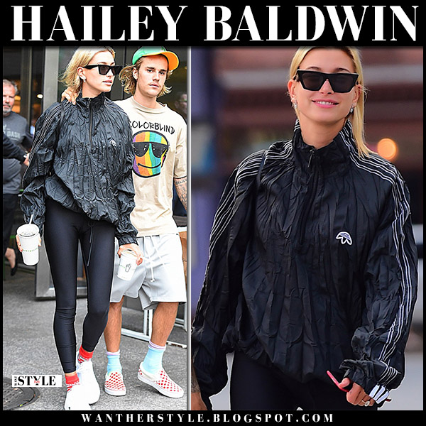 Hailey Baldwin in black jacket, black leggings and sneakers adidas falcon casual off duty style august 13