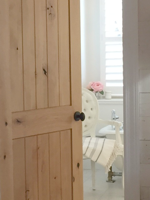 Knotty alder door to master bathroom renovation in Chicagoland fixer upper by Hello Lovely Studio