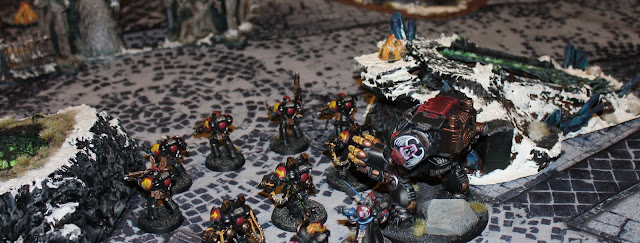 A battle between Warhammer 40k and Age of Sigmar. Ultramarines vs Slaves to Darkness.