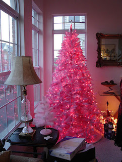 A pink Christmas lit up in a cozy household scene