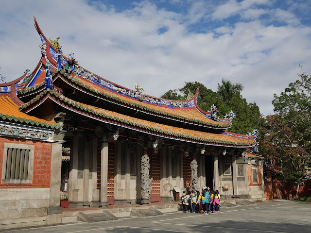 Group of young students in front of Ling-Xing Gate at the Taipei Confucius Temple