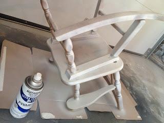 spray primer on rocking chair