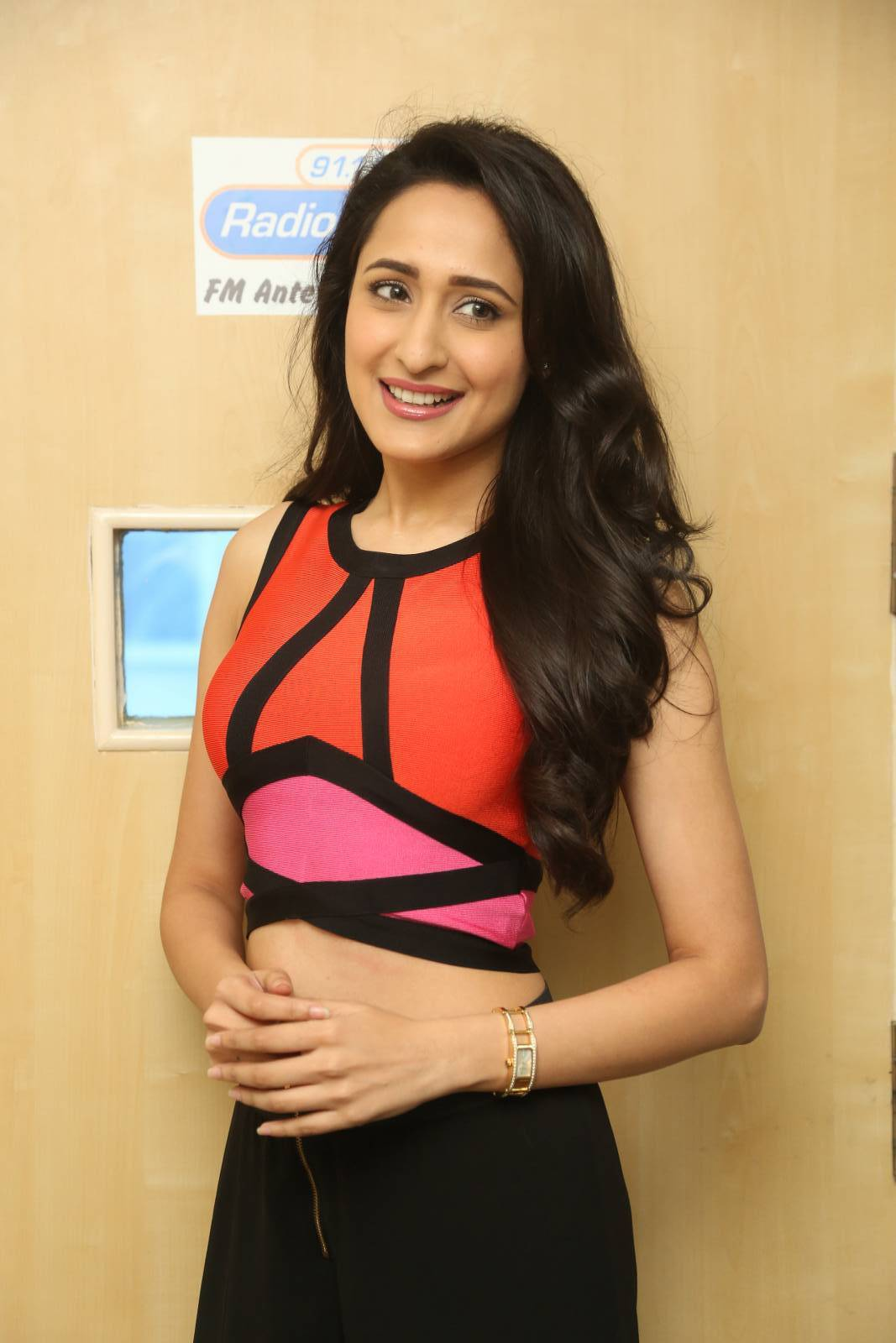Tollywood Actress Pragya Jaiswal Hot Long Hair Style Photos In Orange Top