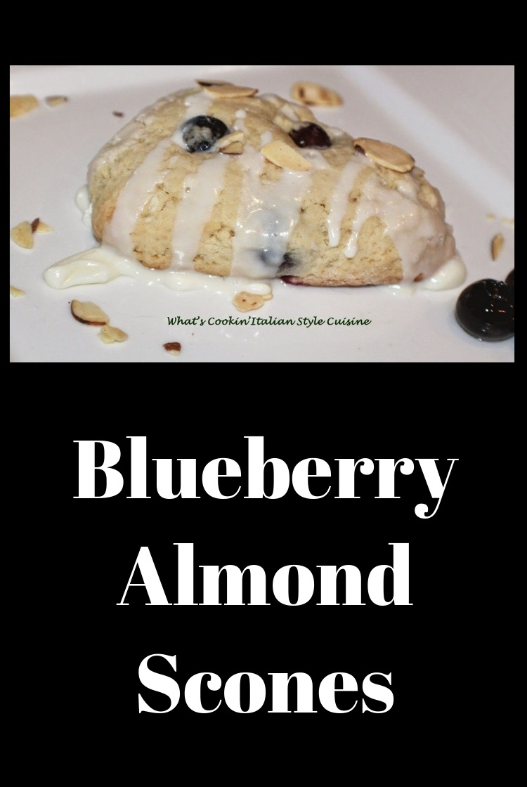 these are a delicious blueberry almond homemade buttery flavored baked biscuits called scones. These have blueberries in them with a drizzle of thin frosting over the top with slivered almonds. They are usually eaten at breakfast time in European pastry shops. This is an American version of scones. These are made with almond milk and some heavy cream for a rich flaky texture.