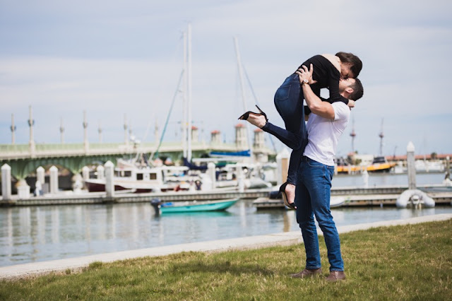 engagement session on the marina by boats