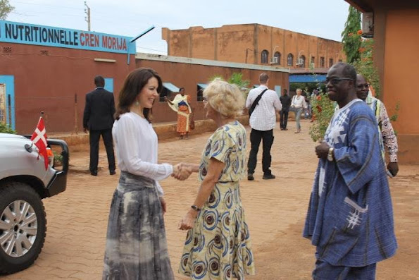 Crown Princess Mary of Denmark visited the various charitable projects. Princess Mary wore Heartmade dress