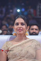 Actress Rakul Preet Singh Stills in Golden Embroidery saree at Rarandoi Veduka Chuddam Audio Launch .COM 0024.jpg
