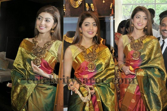 70d06d1077638c South Indian actress Pranitha wearing green and maroon color shimmer silk  saree with gold zari border, brocade work huge pallu. Paired with sleeve  less silk ...