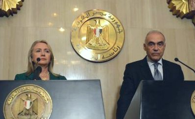 Hillary Clinton and Foreign Minister Mohammed Kamel Amr