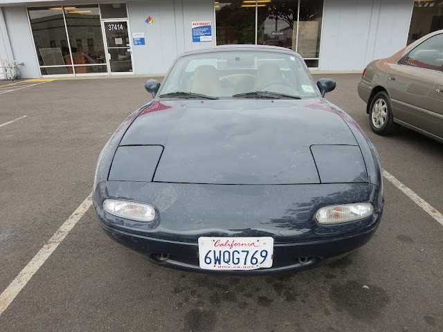 Miata with old, faded auto paint