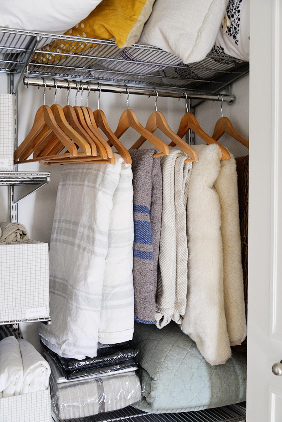 linen closet organization ideas, ideas for linen closet, how to store blankets, blankets on hangers