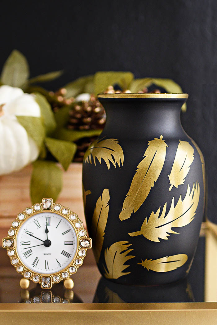 Recreate the $298 Futura Feathers Vase for about $5-$10 with this super easy DIY tutorial inspired by Jonathan Adler. The black and gold colors look chic!