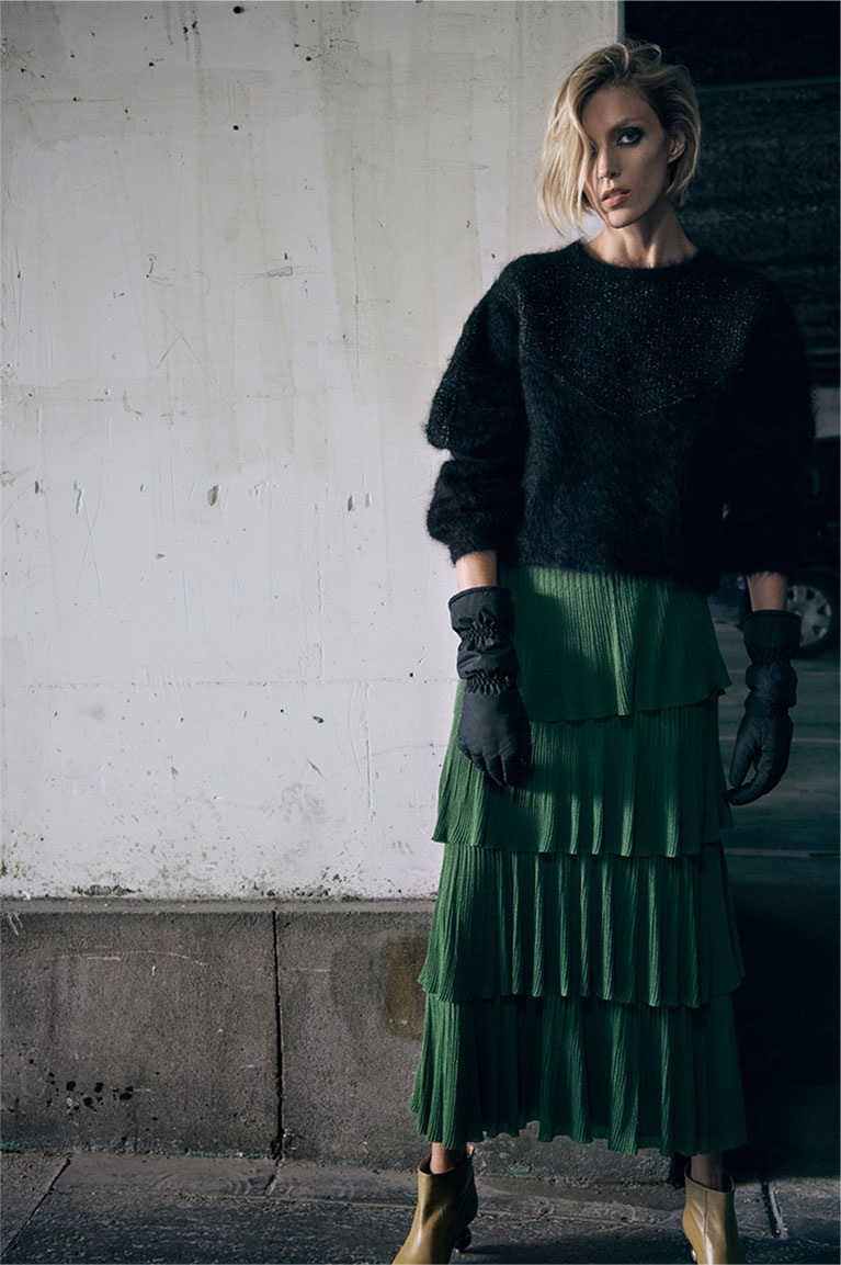 Zara Black Sweater, Green Pleated Skirt and Nylon Gloves