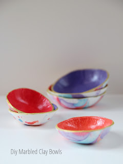 Make these Diy Marbled Clay Bowls using nail varnish.