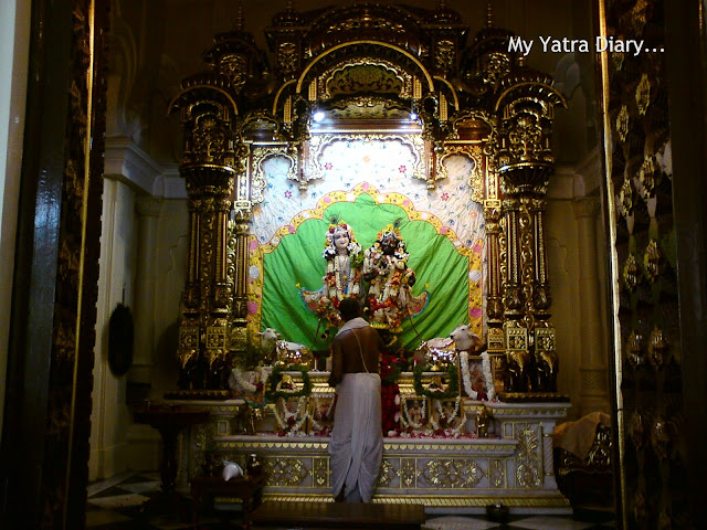 A priest offers prayers to the Radha-Krishnadeity at the ISKCON temple, Vrindavan