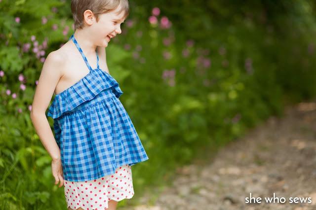 Blue check ruffle top, spotty pink shorts