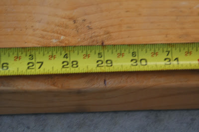 Using a tape measure to measure shelf