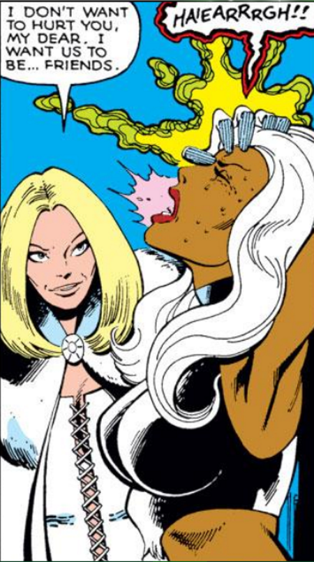 A blonde white woman, Emma Frost, places her hand on the forehead of a black woman, Storm, with long, white hair. Storm screams as Emma Frost says, 'I don't want to hurt you, my dear. I want us to be... friends.'