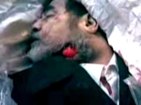 مقطع مسرب لآخر لحظات صدام حسين قبل الدفن !! مقطع نادر ومؤلم جدا