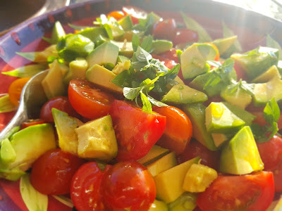 Tomato and Avocado Salad with some Basil.