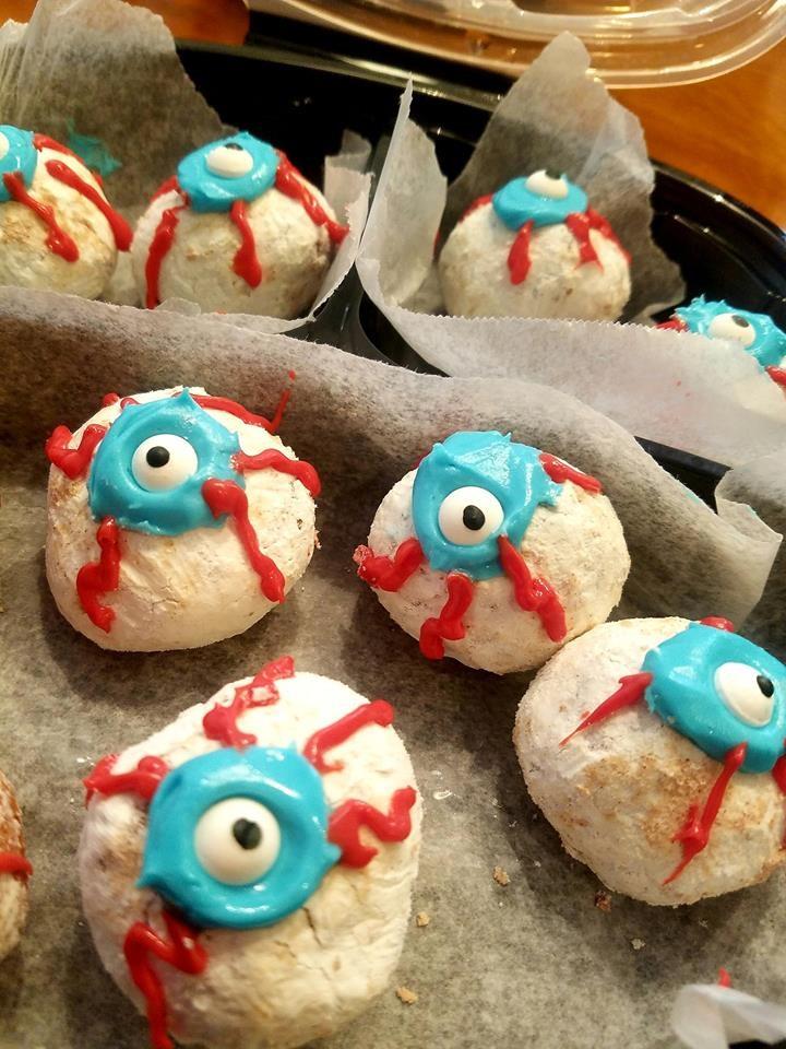 store bought doughnut holes made into Halloween eyeballs.