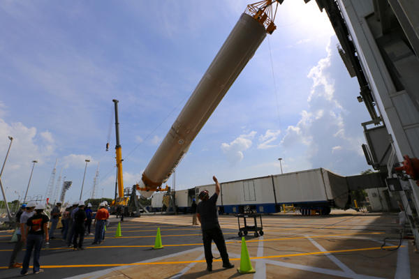 The Atlas V booster is lifted up prior to being installed inside the Verticial Integration Facility at Cape Canaveral Air Force Station's SLC-41...on May 28, 2020.