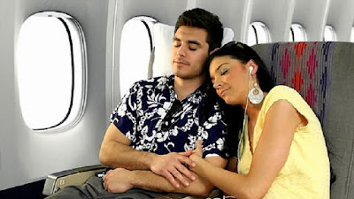 Passenger sleeping in aircraft