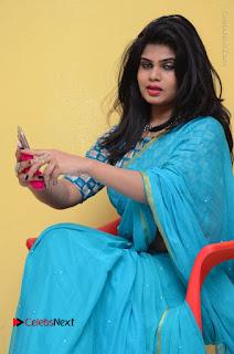 Telugu Actress Alekhya Stills in Green Saree at Swachh Hyderabad Cricket Press Meet  0073.JPG