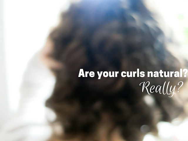 Blurred image of curly hair.