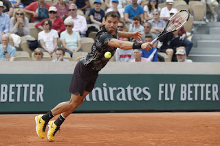 Dimitrov outlasts Cilic in 5-set marathon
