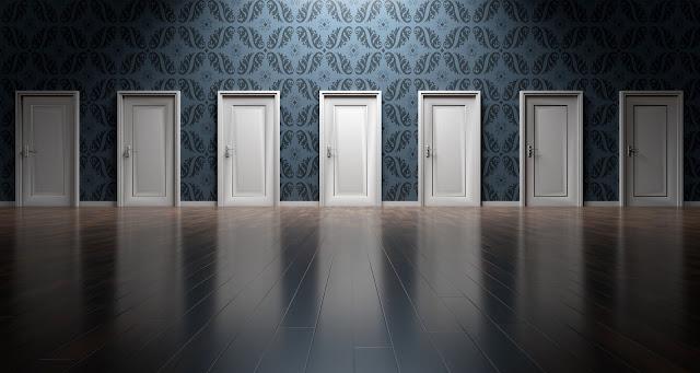 7 doors in an empty room