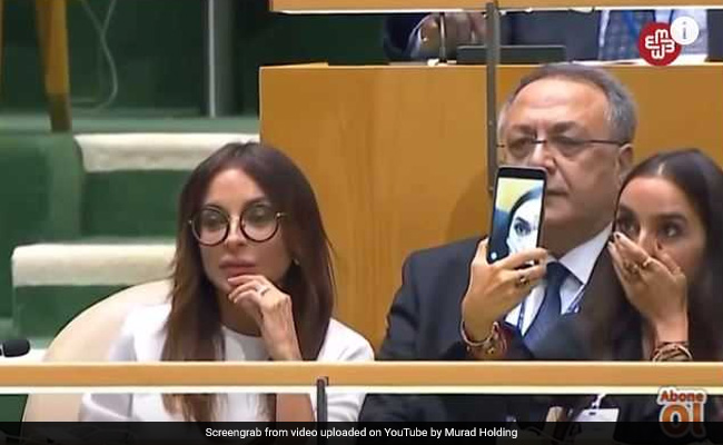 Video: World leader's daughter takes selfie during UN genocide speech