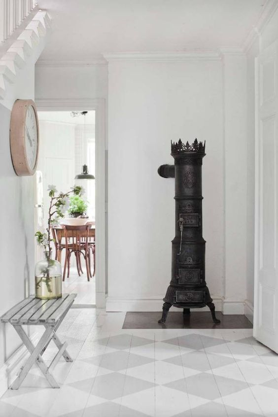 Breathtaking beautiful Swedish style foyer with checks painted on floors - found on Hello Lovely Studio