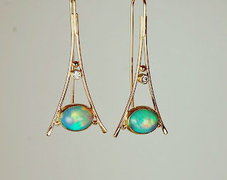 18k triangular shaped earrings with Ethiopian opals.
