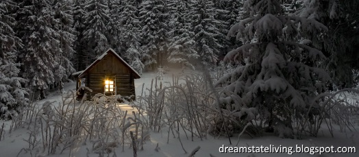 winter landscape in the evening, snow covered trees and a little hut with lights in the window