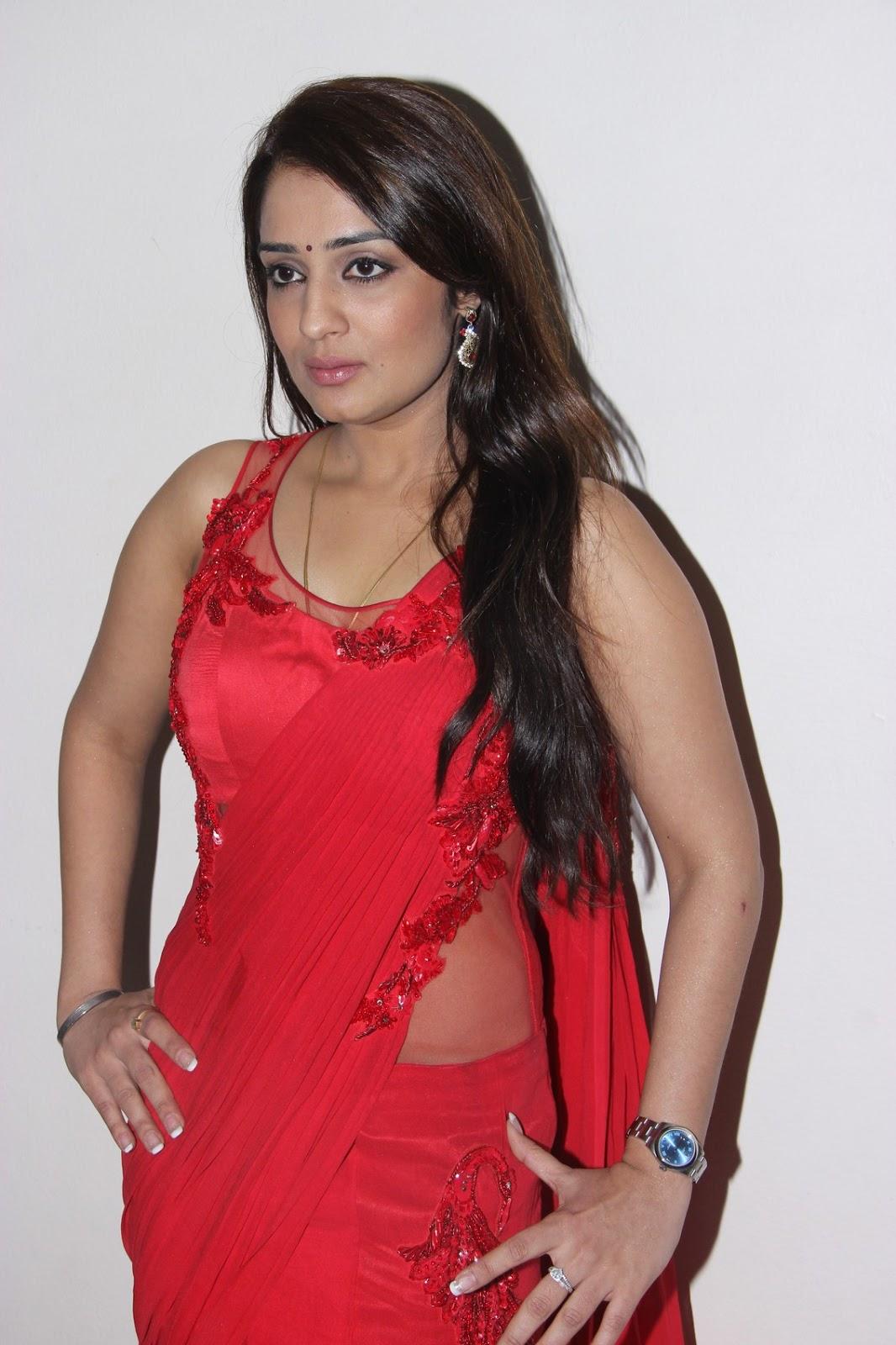 Nikita Thukral Hot Photoshoot In Red Saree