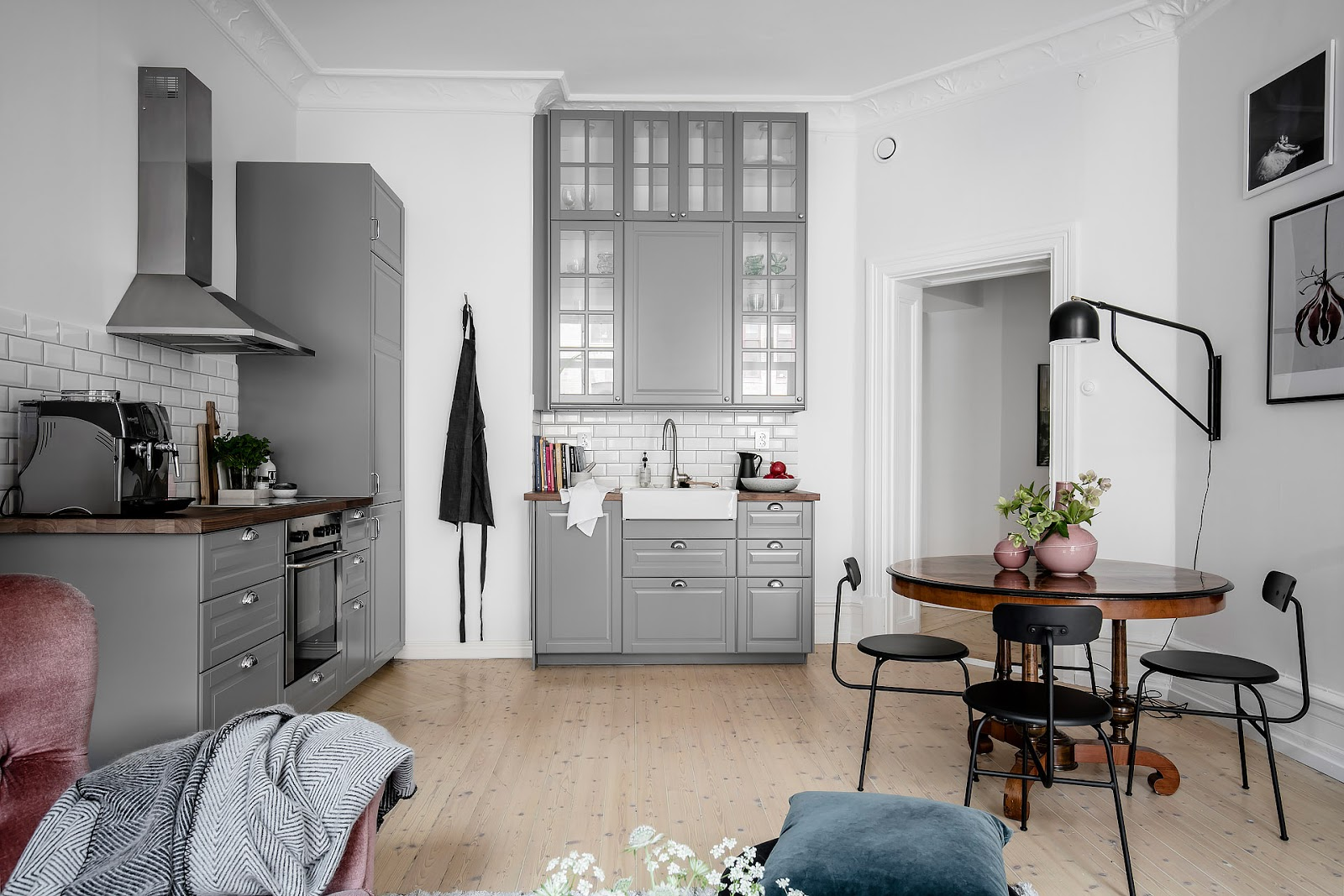 Gray kitchen in a small scandinavian interior, dining place,