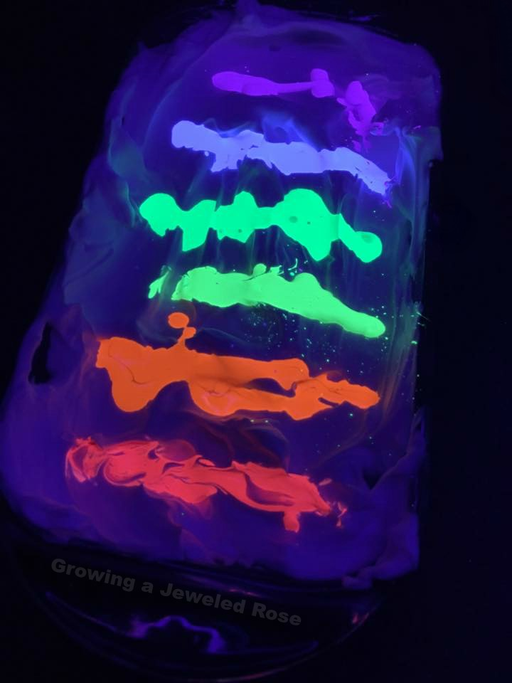 Glowing marbleized egg dying with shaving cream.  This is SO COOL!