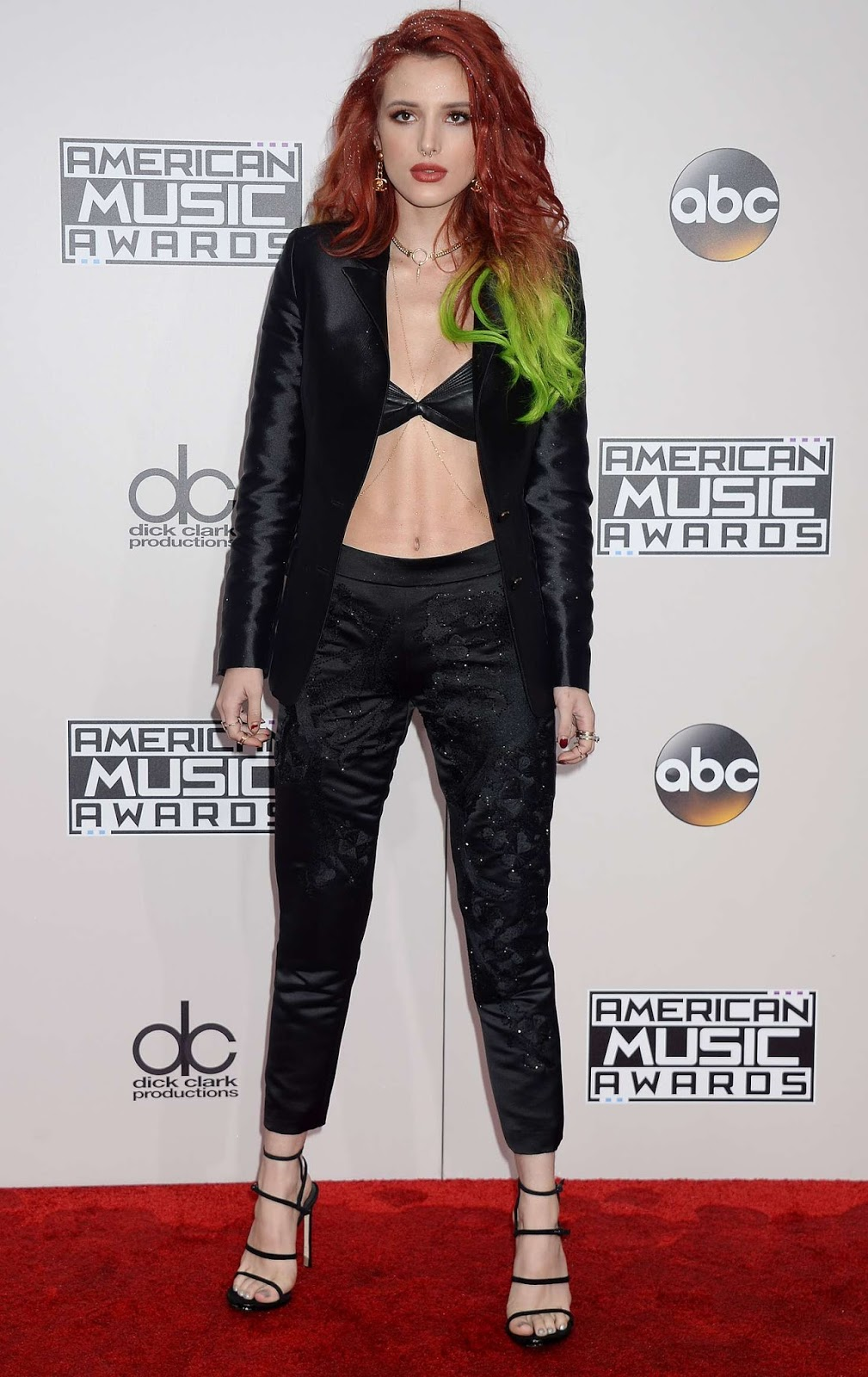 Bella Thorne flaunts leather bra at the 2016 American Music Awards in Los Angeles