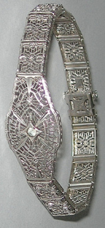 Sterling silver Art Deco filigree bracelet by JH Peckham.