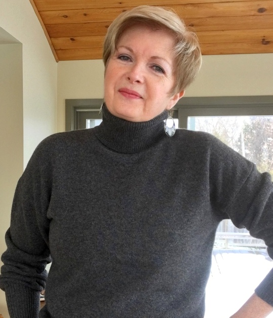 woman smiling in grey sweater