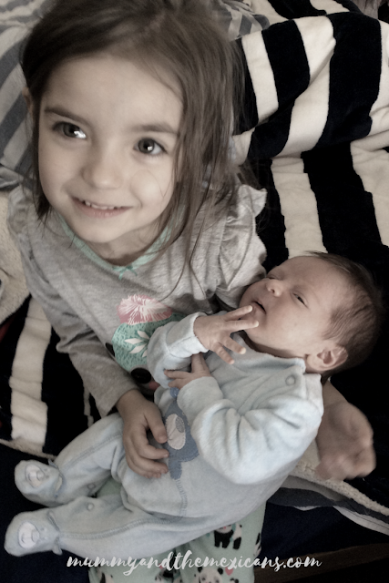 My Mexican Pregnancy - Birth Story - Image Shows A Little Girl Holding Her Baby Brother