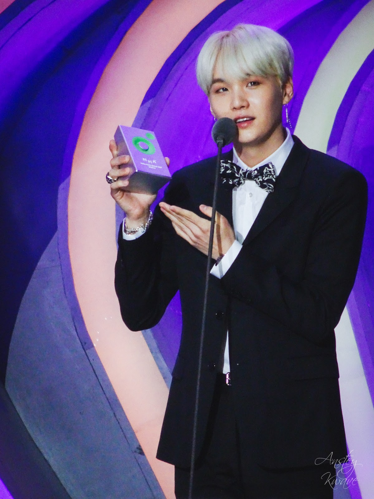 Suga, member of famous Korean k-pop boy band BTS receiving award on stage at Melon Music Awards (MMA) 2017 in Seoul, South Korea